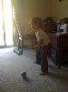bastian playing with his new croquet set